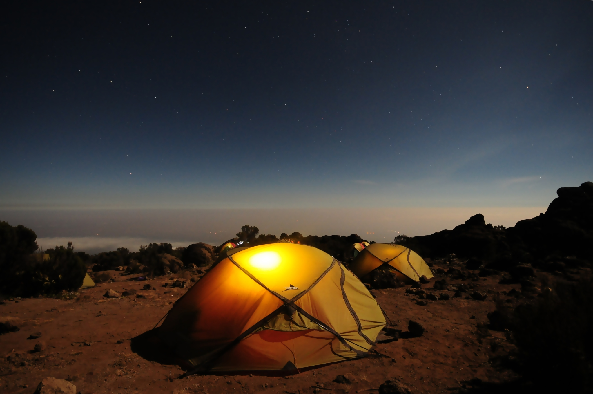 A couple of tents with a nice view of the night sky
